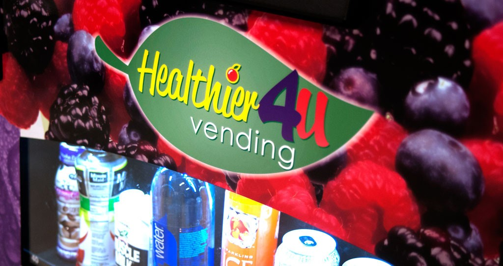 Green red yellow purple Healthier 4u vending logo on front of healthier 4u vending healthy vending machine